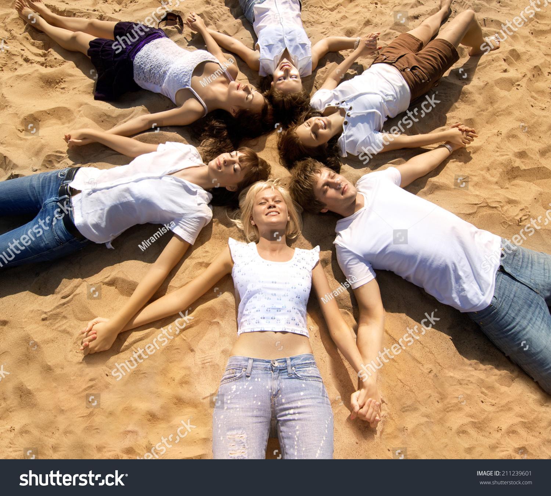 Happy Beautiful Woman Enjoying At Beach Stock Photo: Group Young Friends Enjoying Beach Party Stock Photo