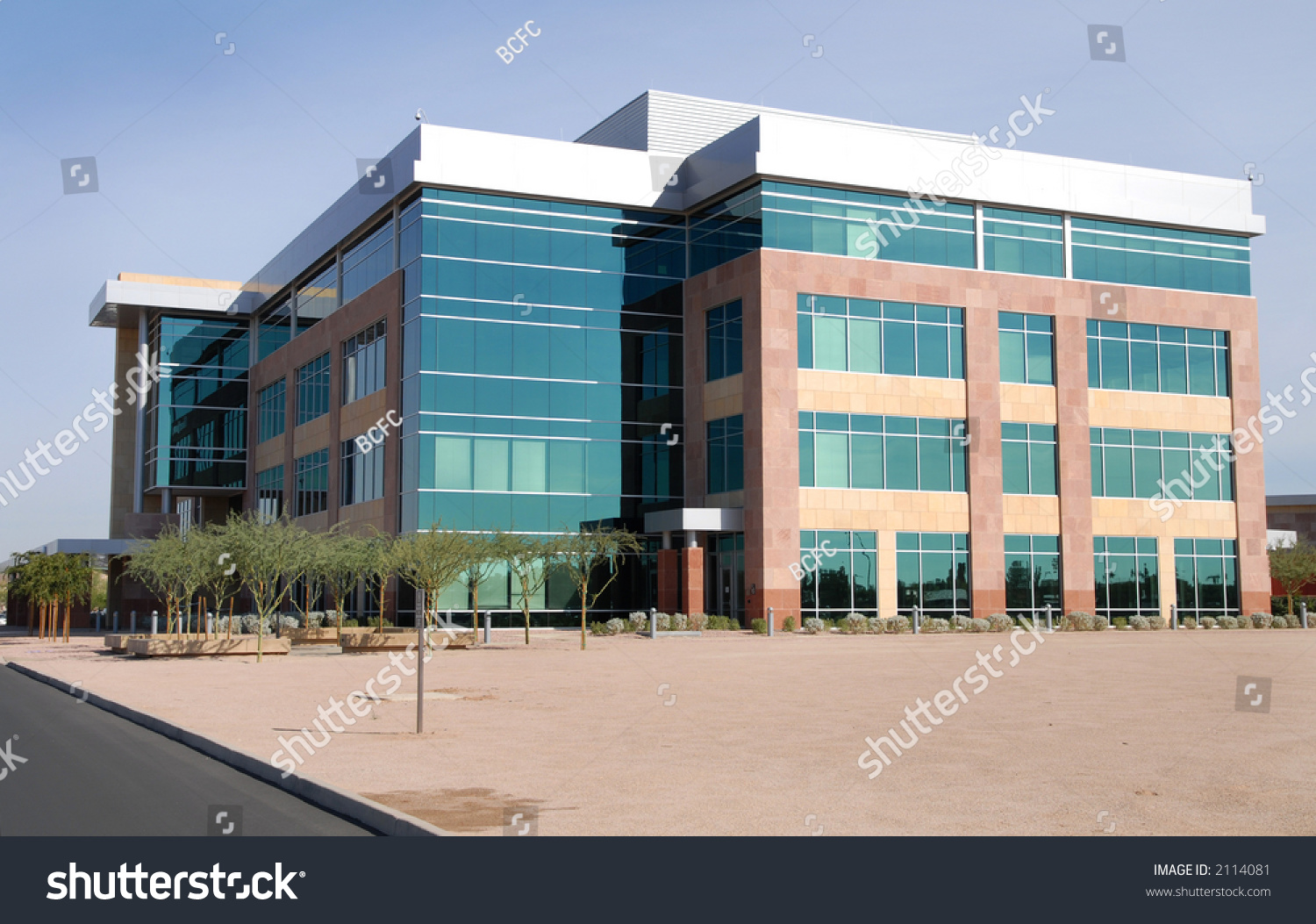 Modern commercial building stock photo 2114081 shutterstock for Modern business buildings