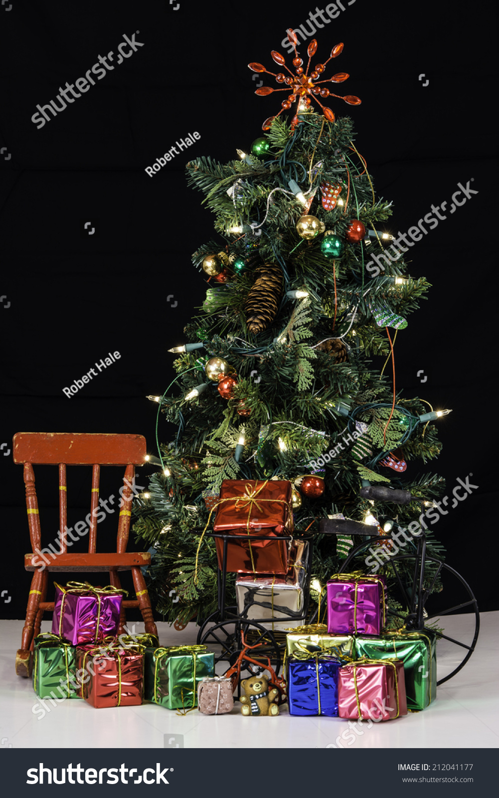 Still life of decorated christmas tree with lights next to