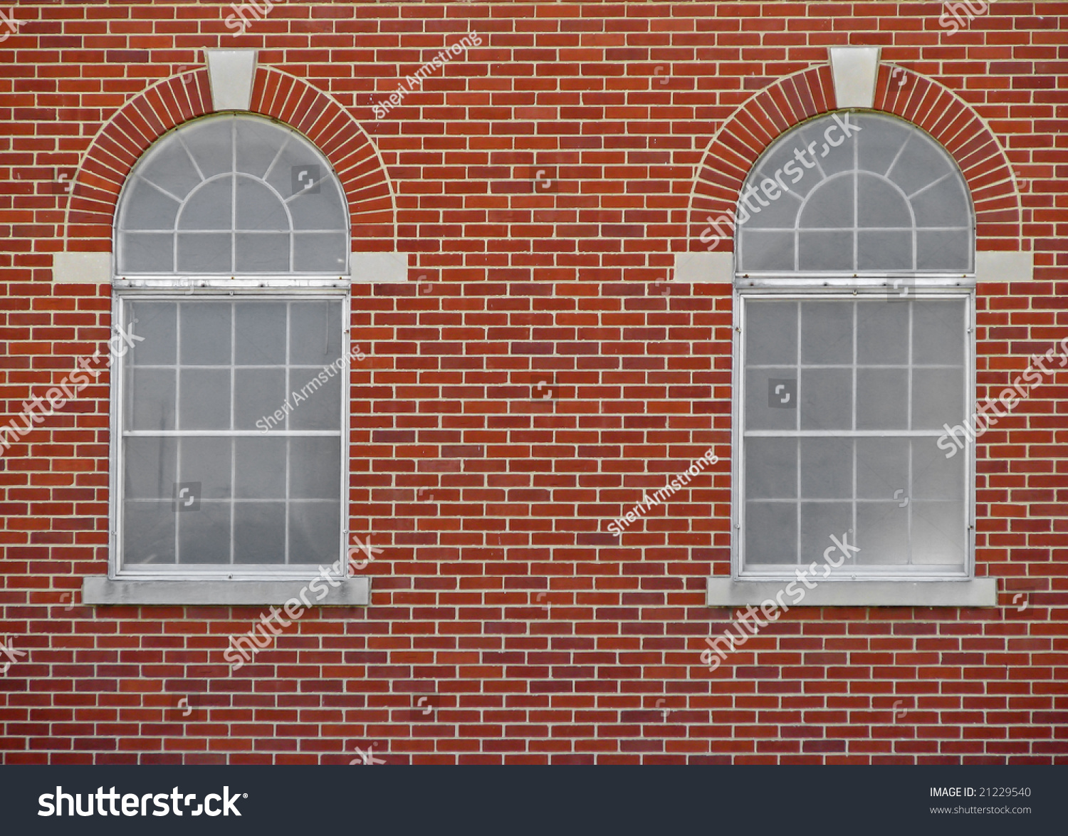 Two Arched Windows On Red Brick Stock Photo 21229540