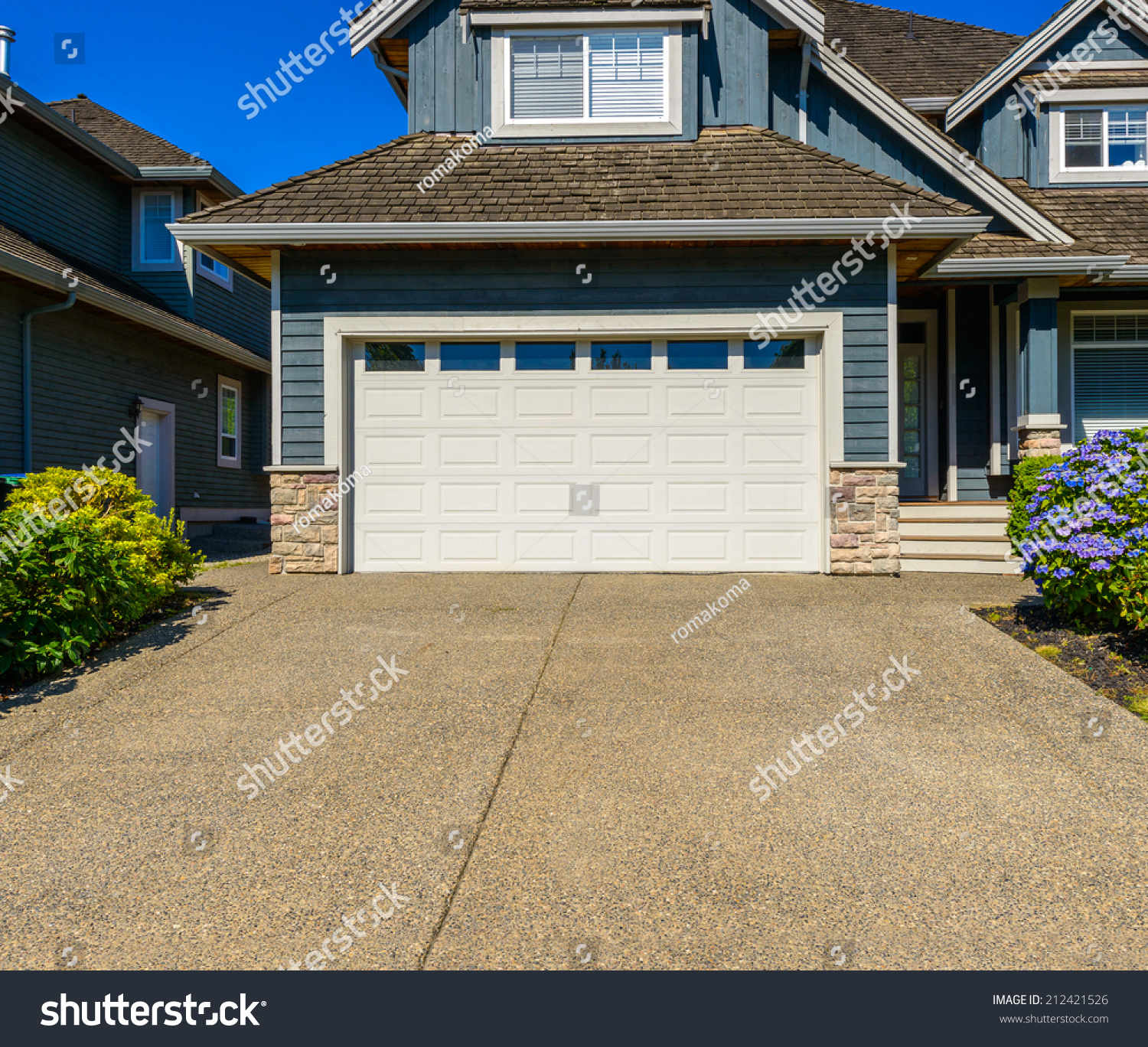 Double doors garage wide long driveway stock photo for How wide should a garage be