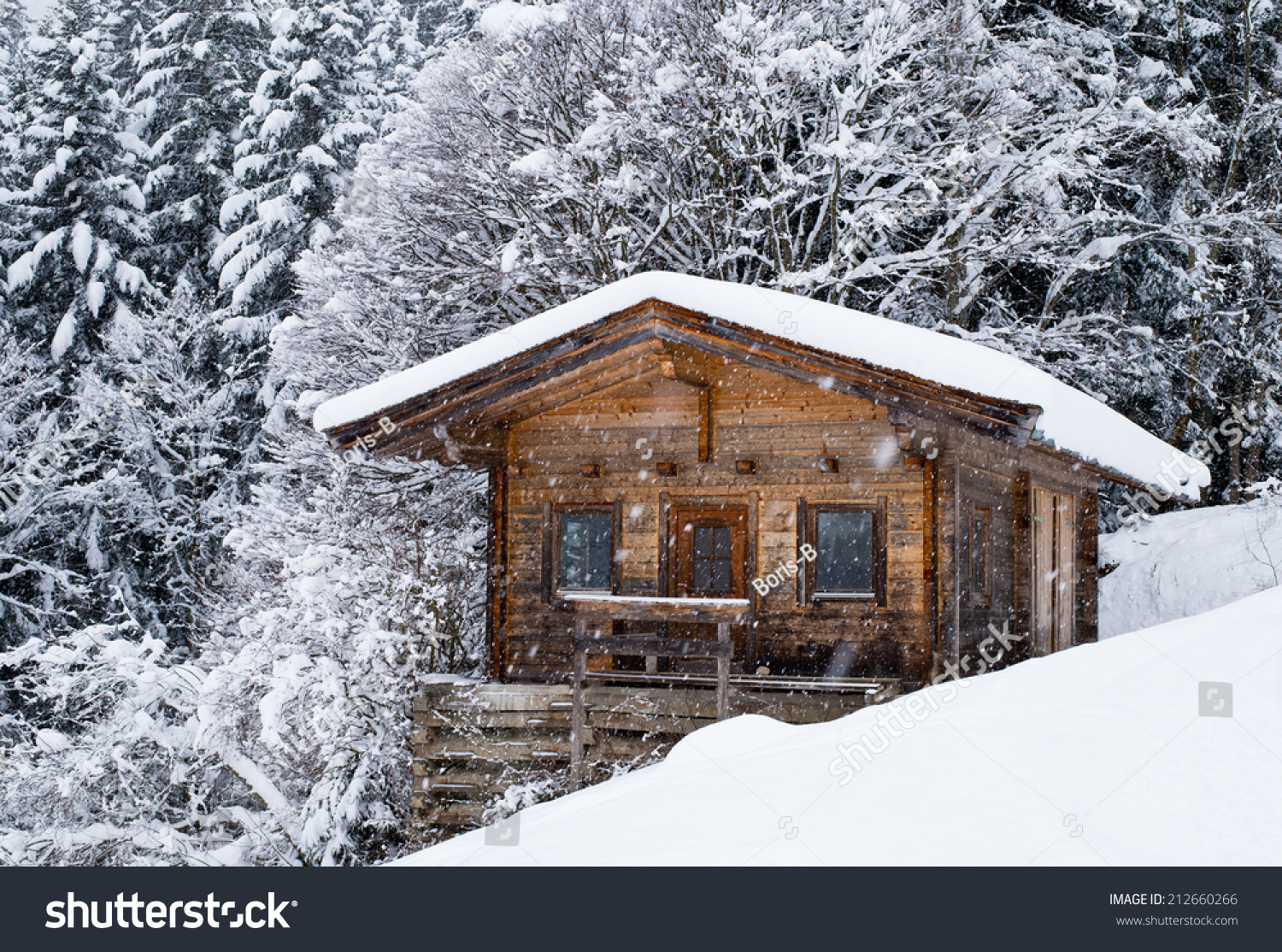 Scenery small wood chalet over snow stock photo