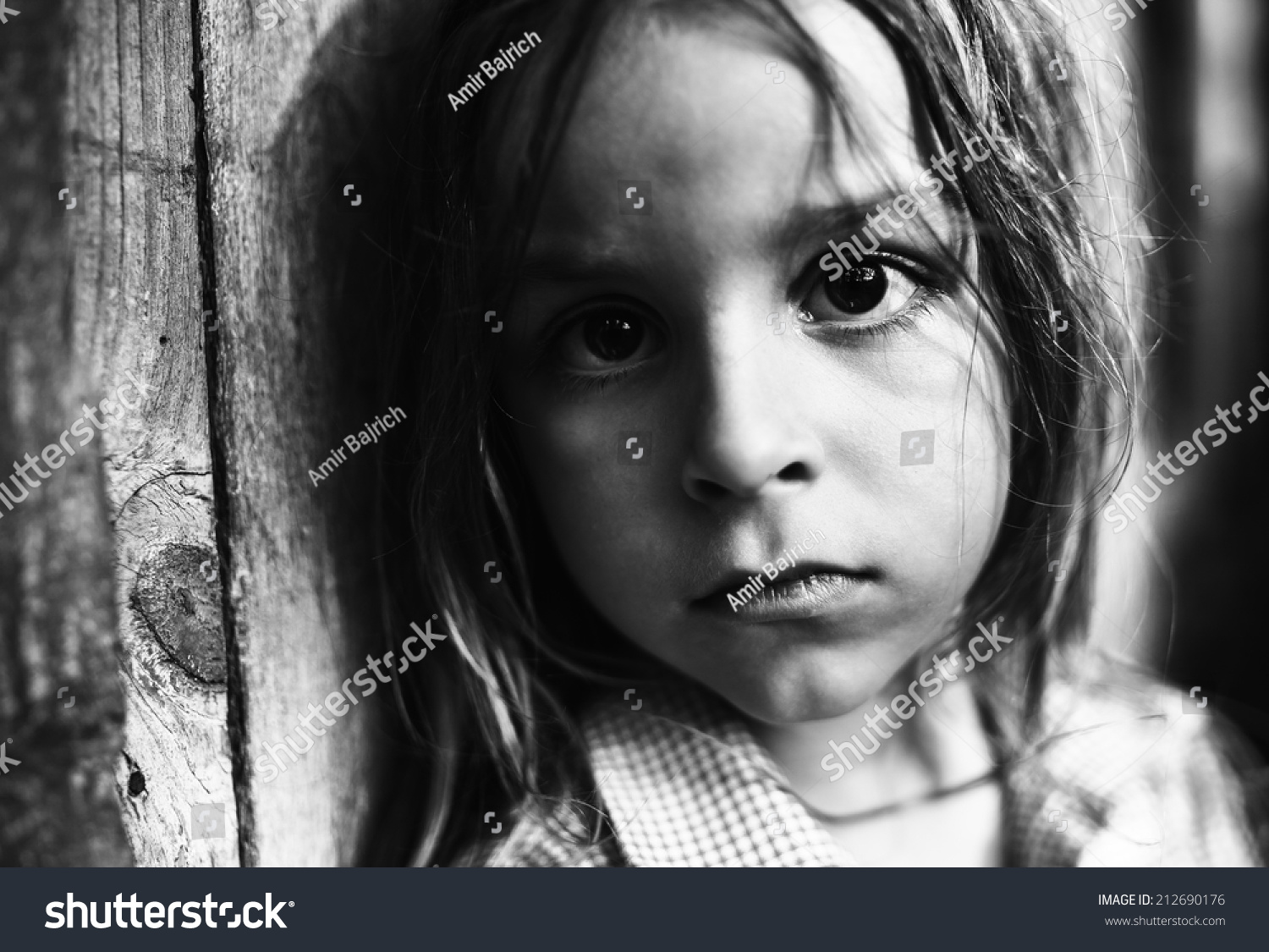 Child portraitboy with big black eyes black and white photography