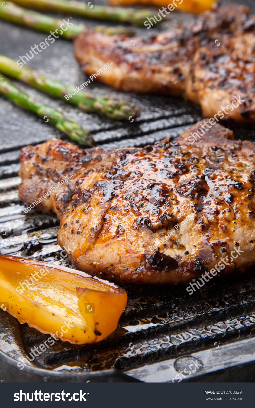 royalty free juicy pork chops are grilled on griddle u2026 212708329