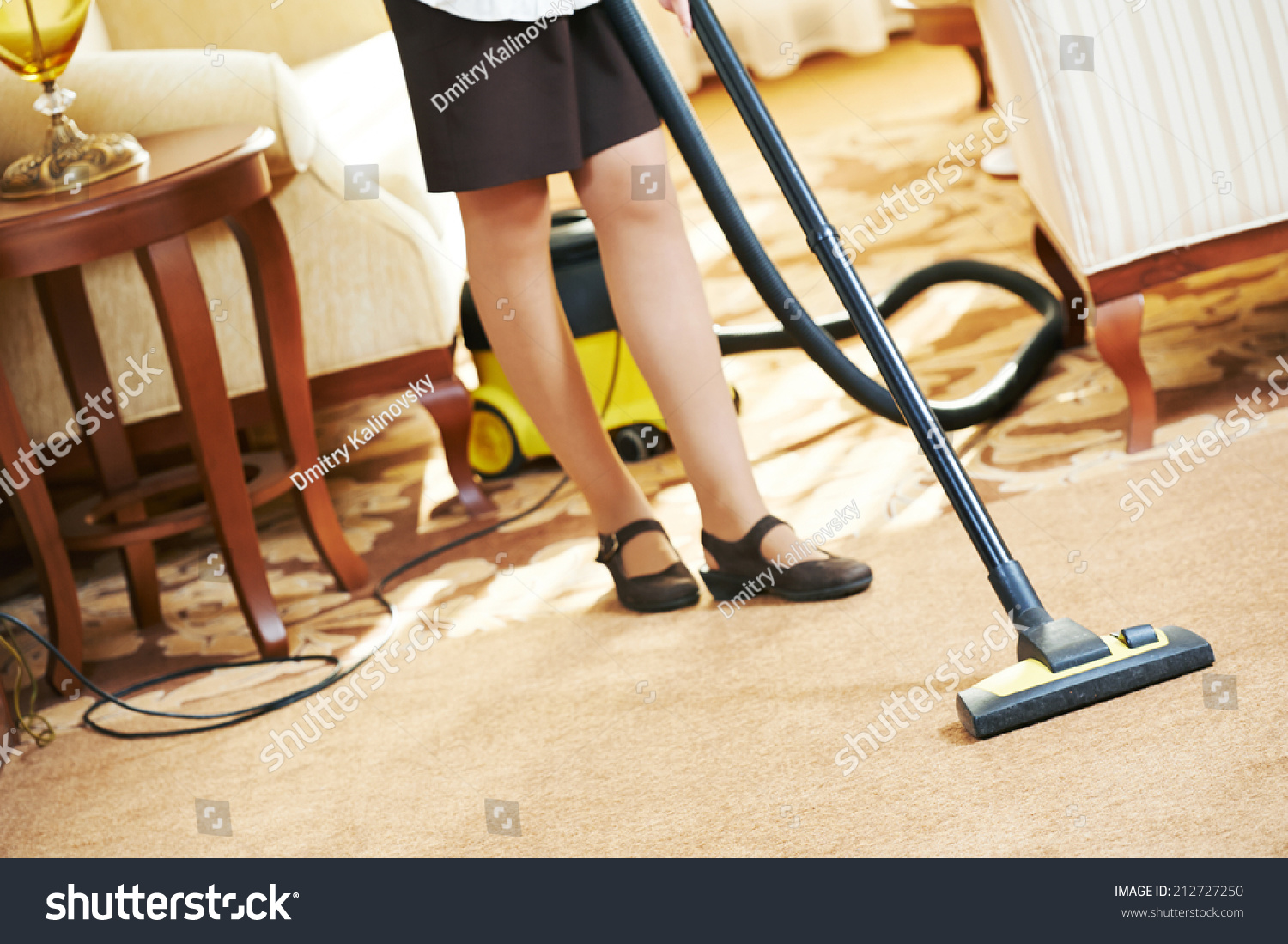 hotel service female housekeeping worker with vacuum