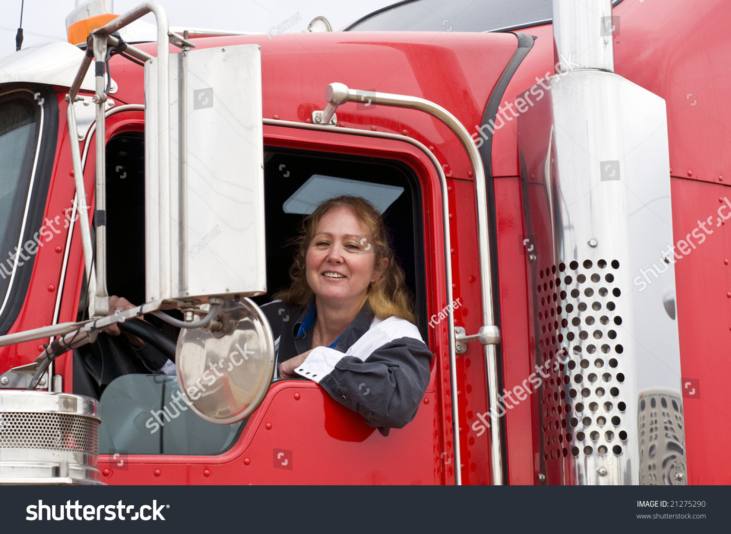 Woman truck driver leaning out the drivers side window