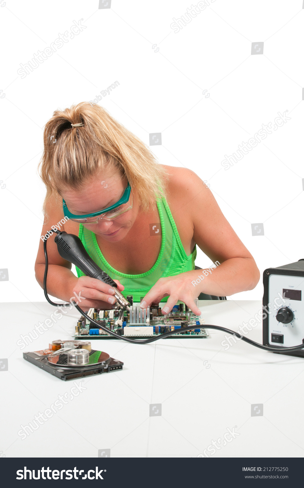 Beautiful Woman Repairing Printed Circuit Board Stock Photo Edit Computer Royalty Free Image A With Forced Air Soldering Iron