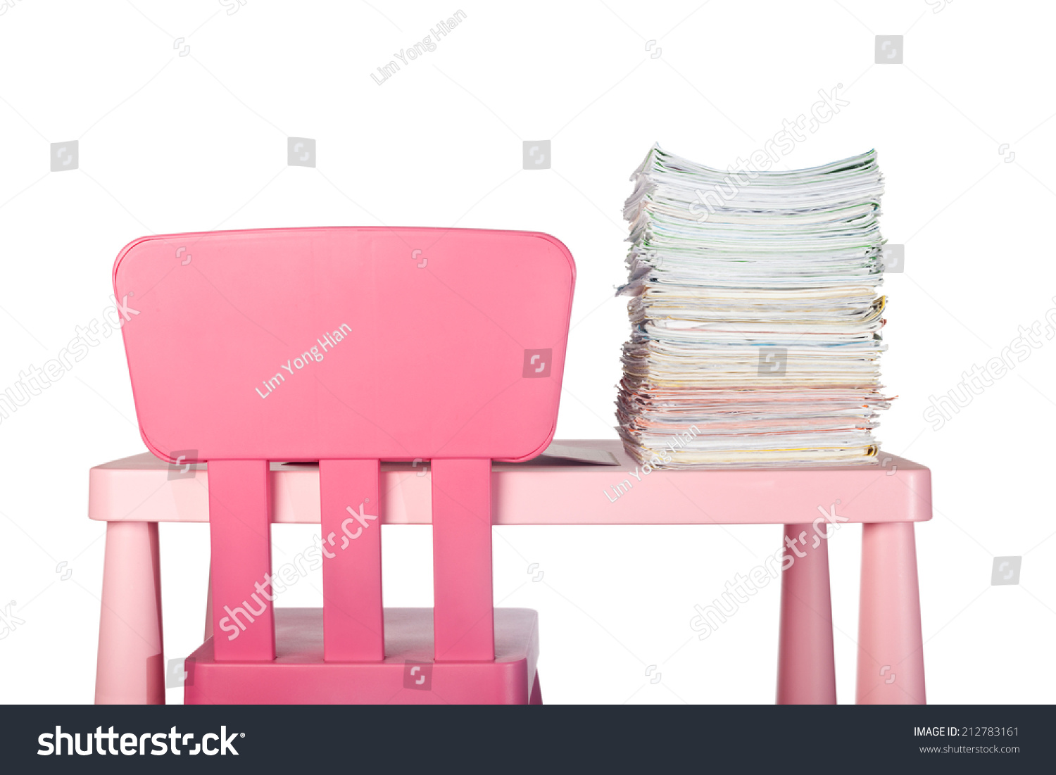 Big Stack Of Homework On A Childu0027s Desk Isolated On White Background