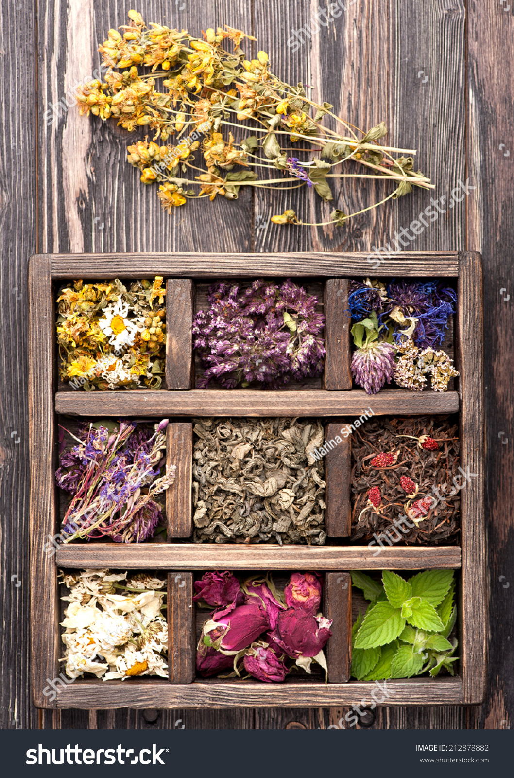 Dried Herbs and flowers in vintage box on wooden background. #212878882