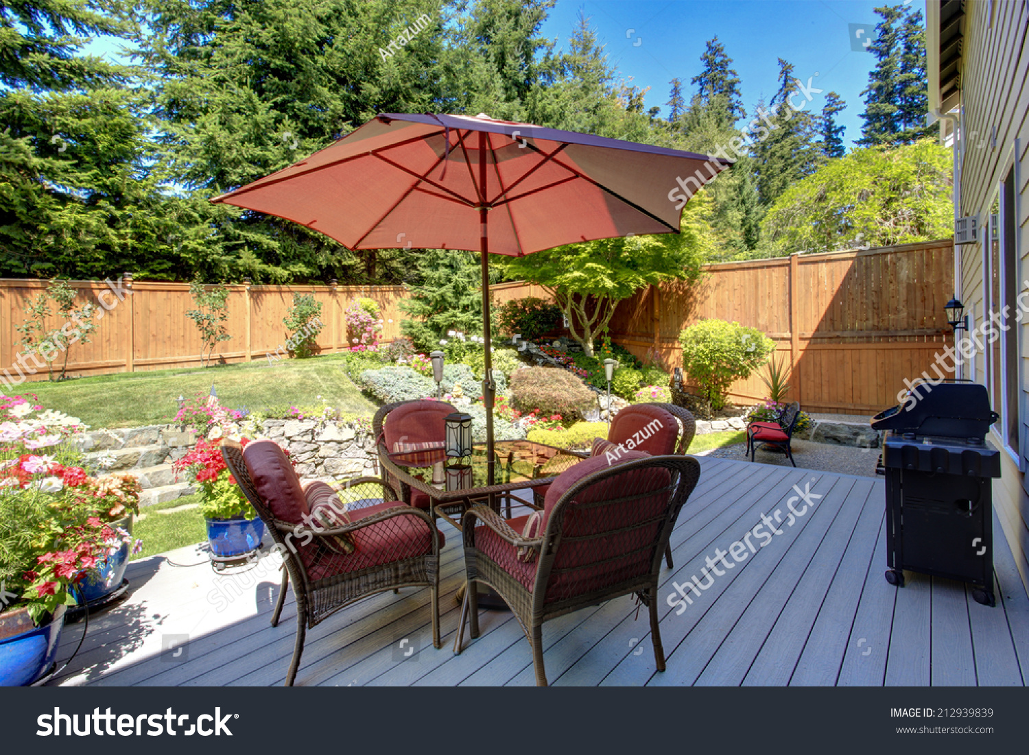 Beautiful landscape design for backyard garden and patio area on walkout deck #212939839