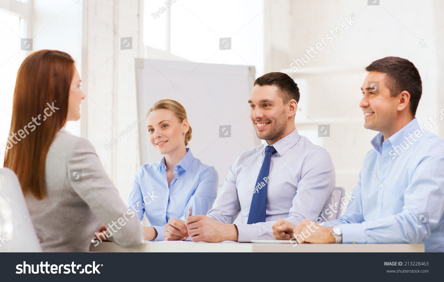 business career and office concept smiling businessw at job save to a lightbox