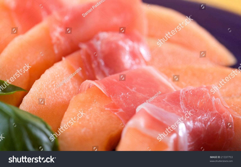Melon Wrapped In Prosciutto Ham. Italian Appetizer. Stock Photo ...