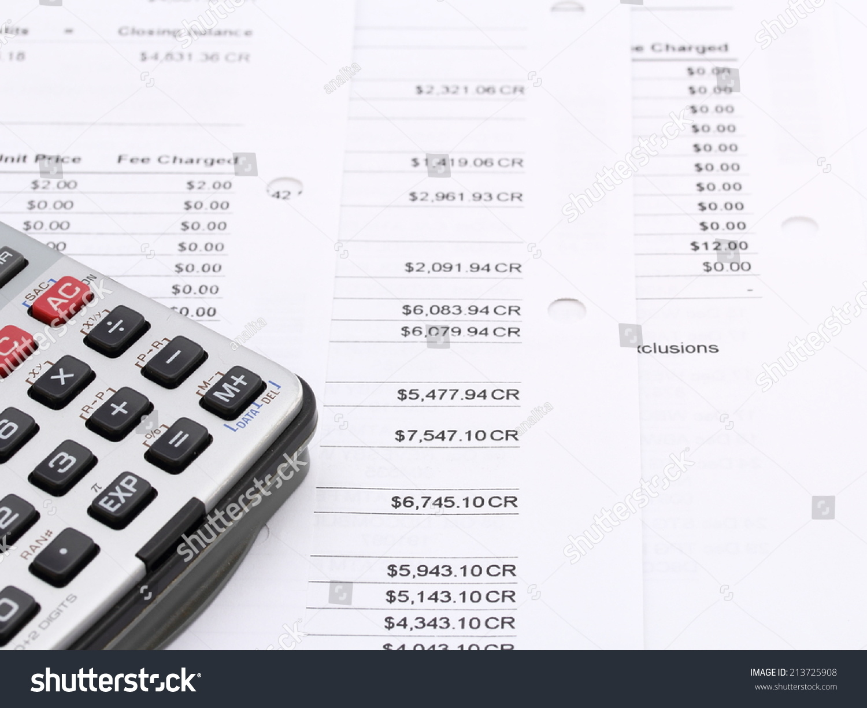 Calculator On Paperwork Financial Business Report Stock Photo (Edit