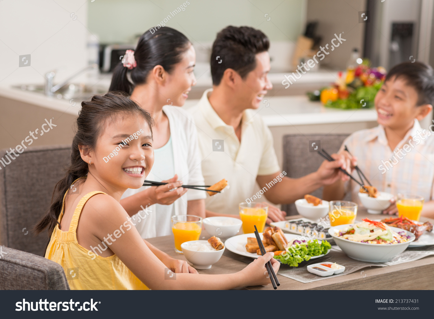 Family dinner table with food - Vietnamese Girl Enjoying National Food At The Family Dinner Table