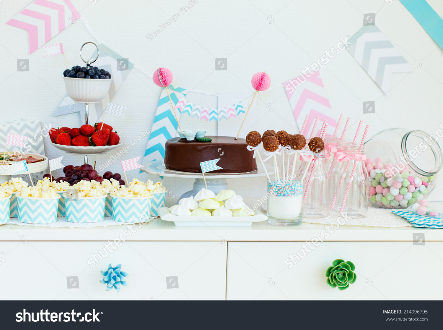Berries popcorn and canape selection at party table stock for Canape selection