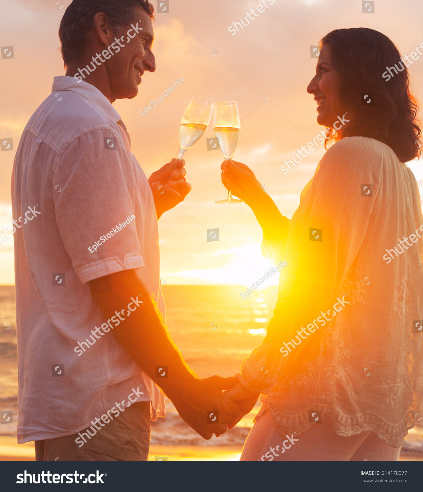 Happy Romantic Couple Enjoying Glass Of Champagne At