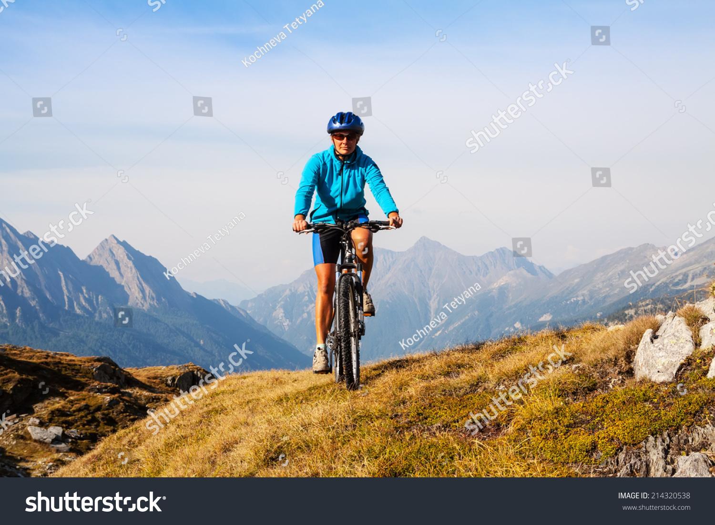 Mountain Biking Woman On Bike Dolomites Italy Stock