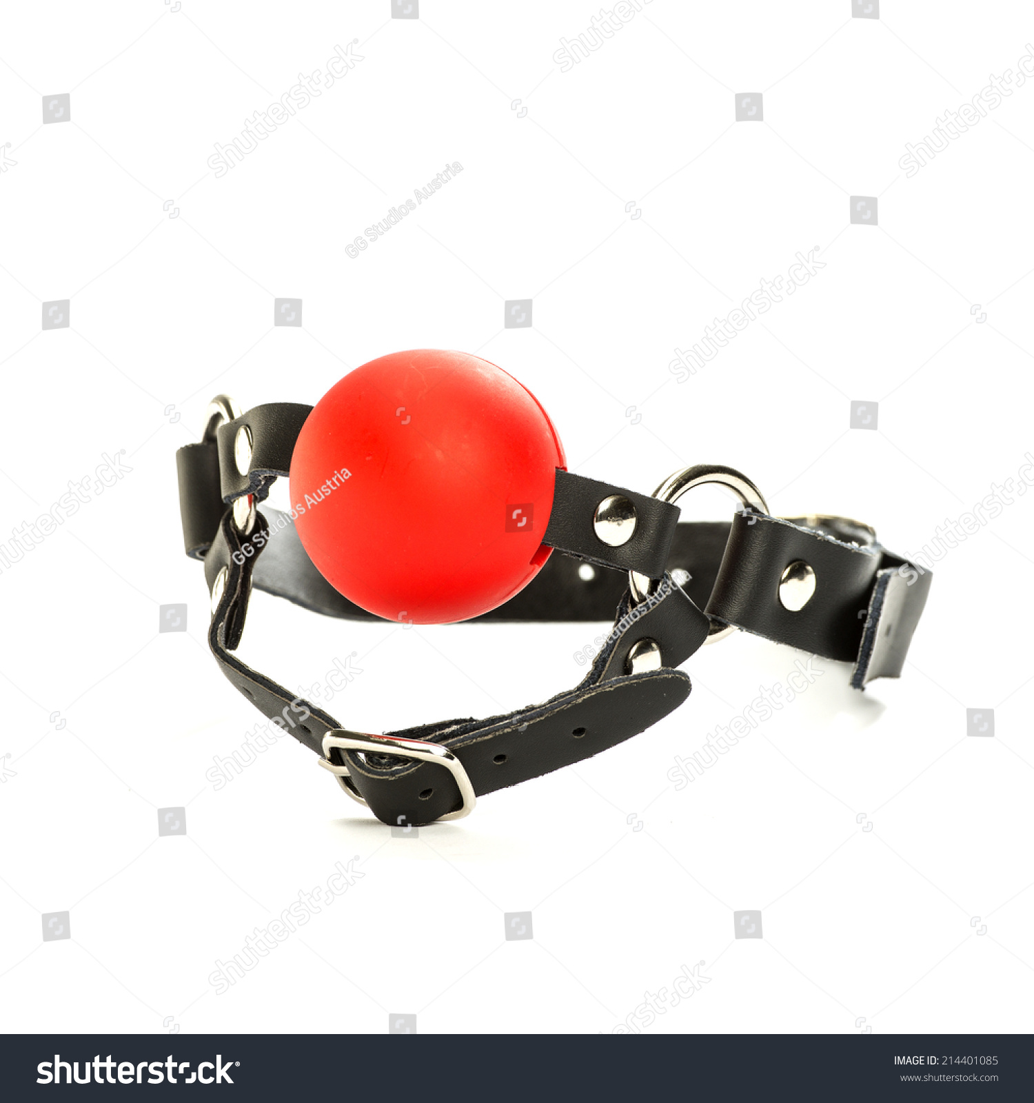 A red ball gag on a leather collar, for fetish and bondare role-playing