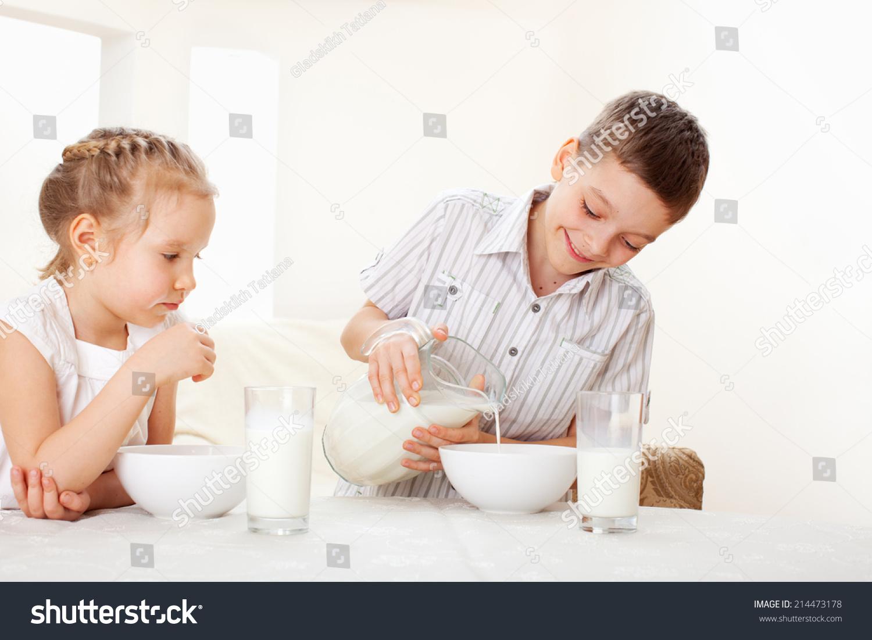 Children Eat Breakfast Family Eating Cereals Stock Photo ...