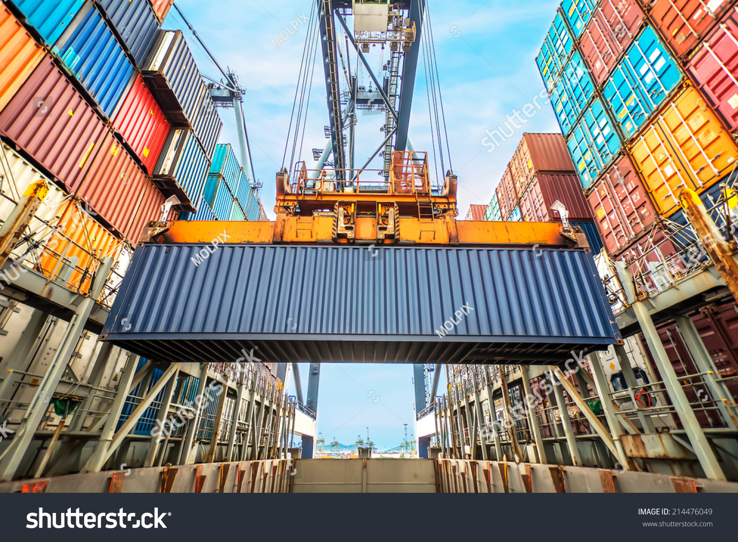 Container loading in a Cargo freight ship with industrial crane. Container ship in import and export business logistic company. Industry and Transportation concept. #214476049