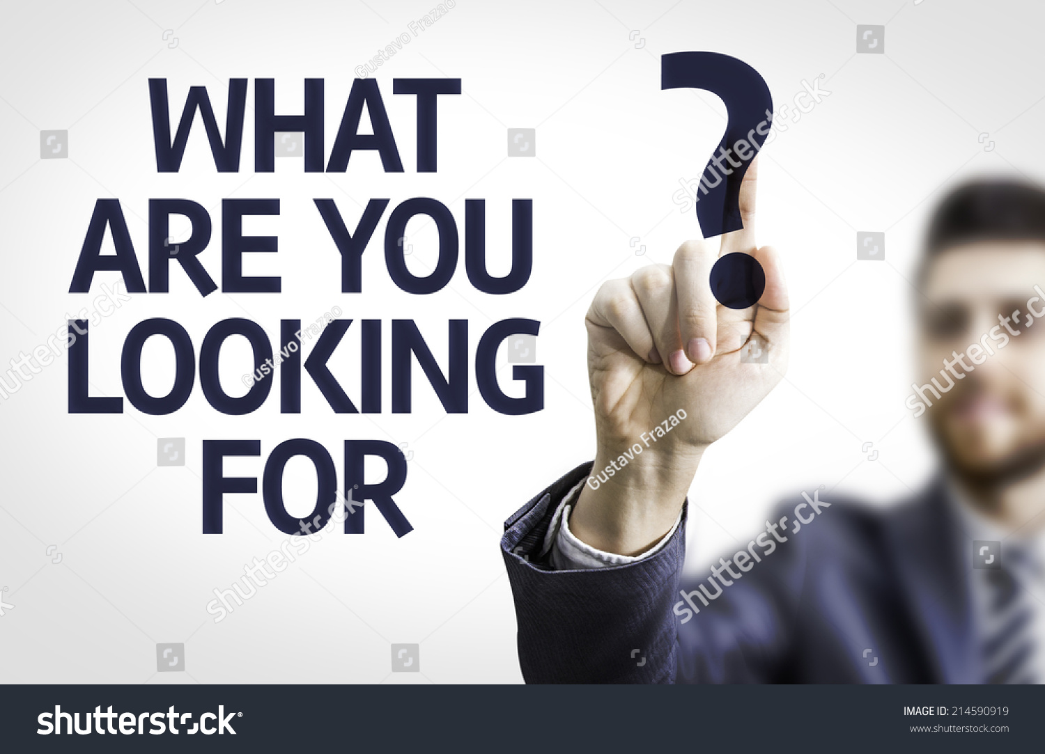 business man pointing transparent board text stock photo  business man pointing to transparent board text what are you looking for