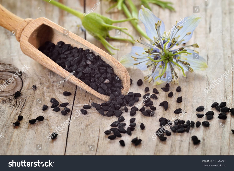 closeup nigella sativa seeds on wooden stock photo 214939591 shutterstock. Black Bedroom Furniture Sets. Home Design Ideas