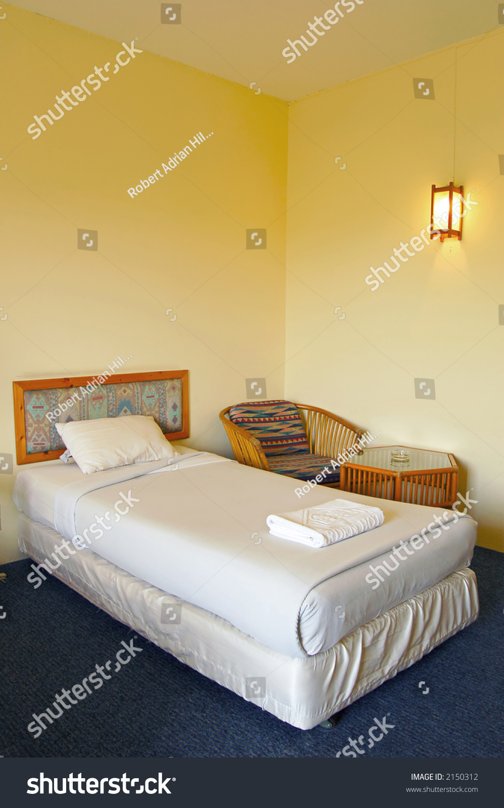 Hotel Room Photography: A Single Bed In A Hotel Room Stock Photo 2150312