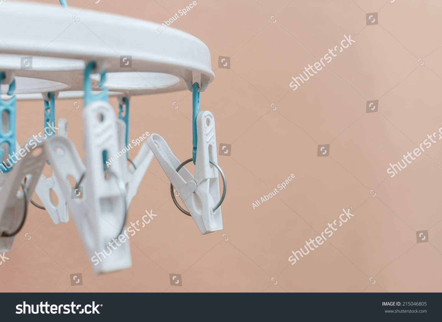 old white plastic clothespins hang stock photo 215046805