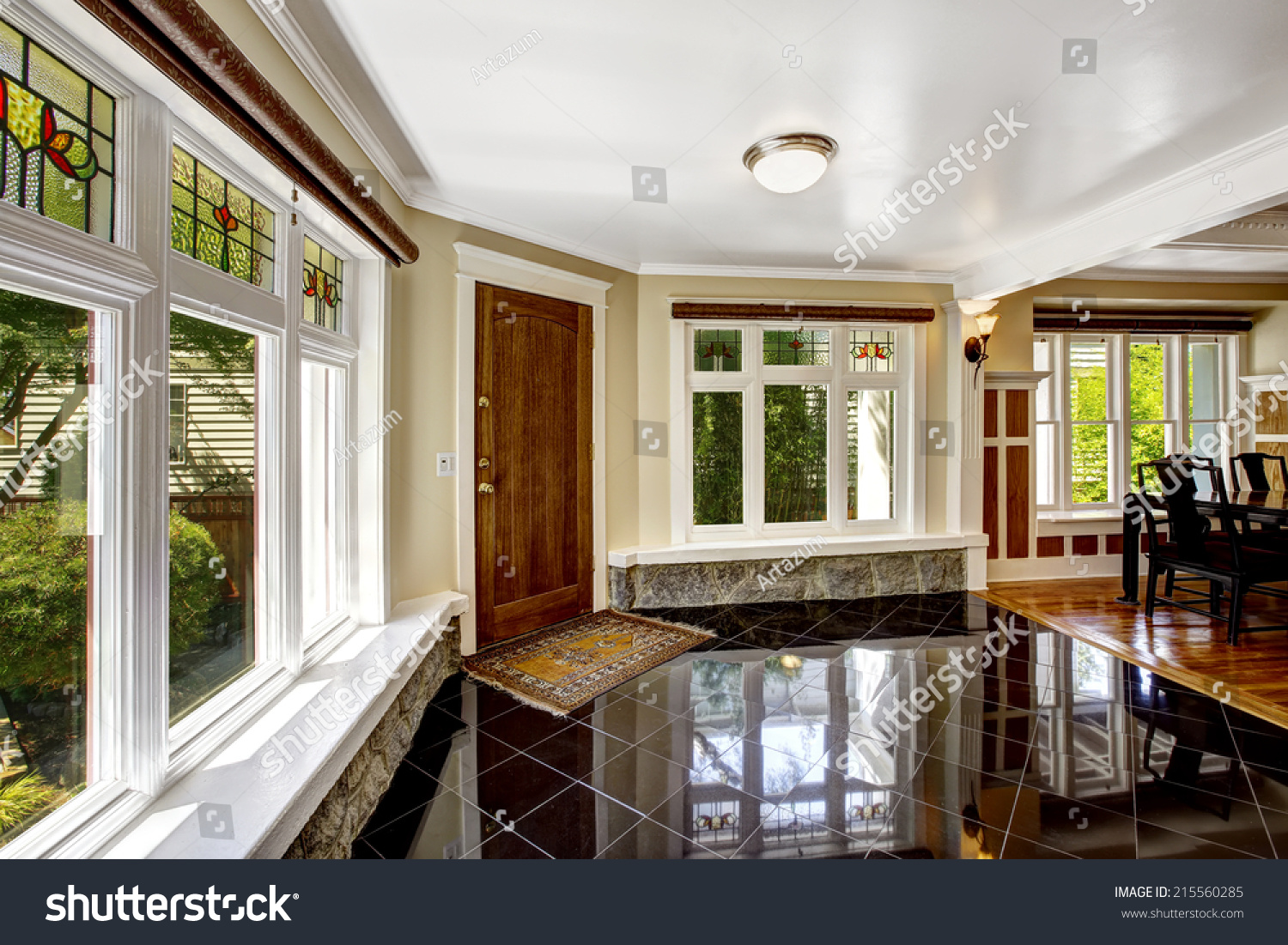 Luxury interior foyer black shiny tile stock photo 215560285 foyer with black shiny tile floor large windows with stone windowsill base dailygadgetfo Images