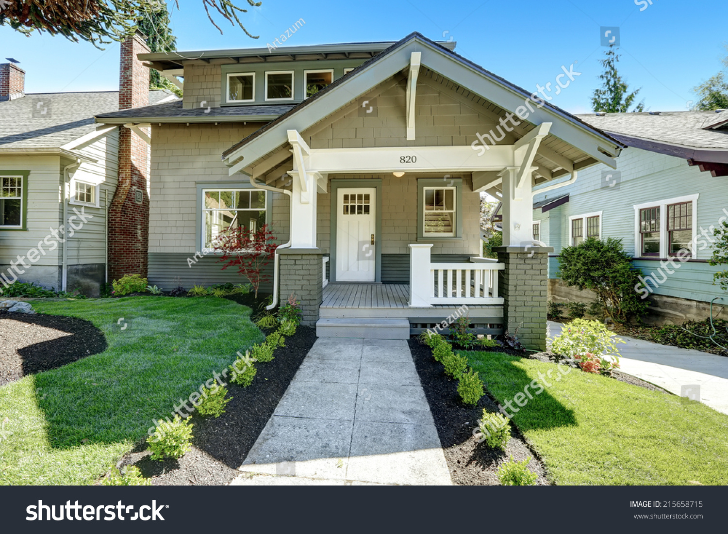 Charming House Entrance Porch With White Wooden Door And White Railings. Front Yard  Landscape With Walkway