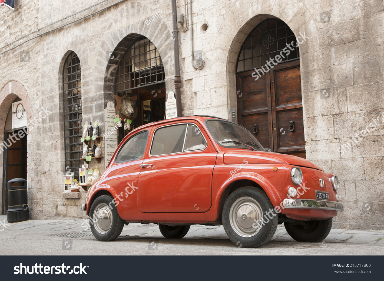 gubbio italy may 13 iconic orange fiat 500 parked in historic street on traditional. Black Bedroom Furniture Sets. Home Design Ideas