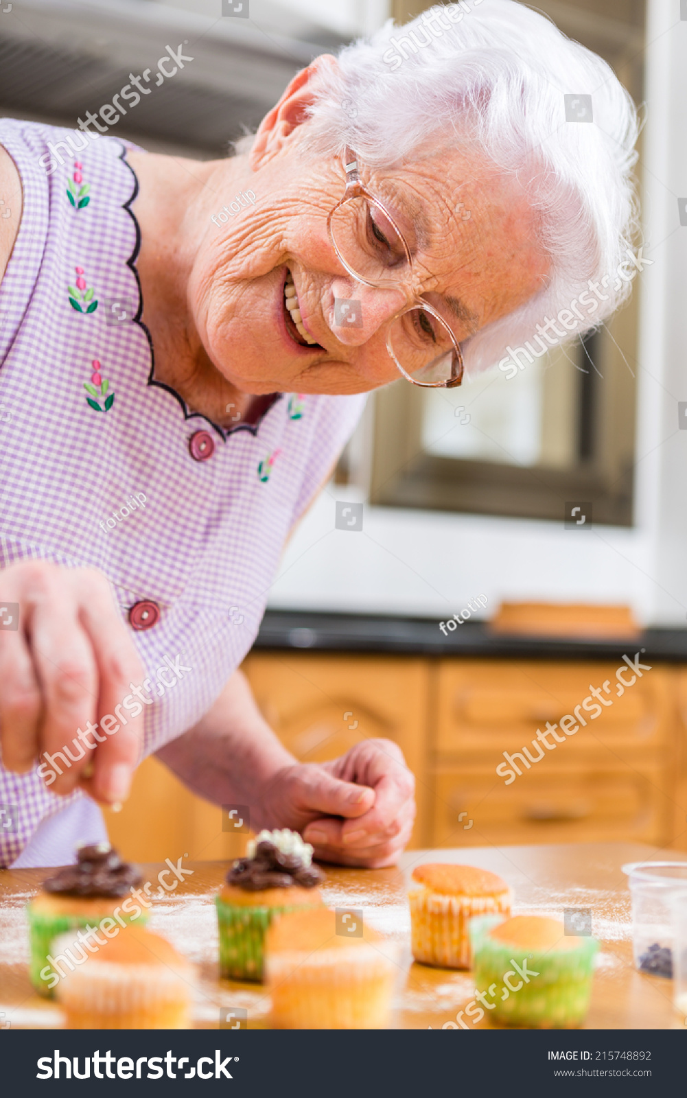 woman decorating cupcakes cute young woman decorating cupcakes old woman making and