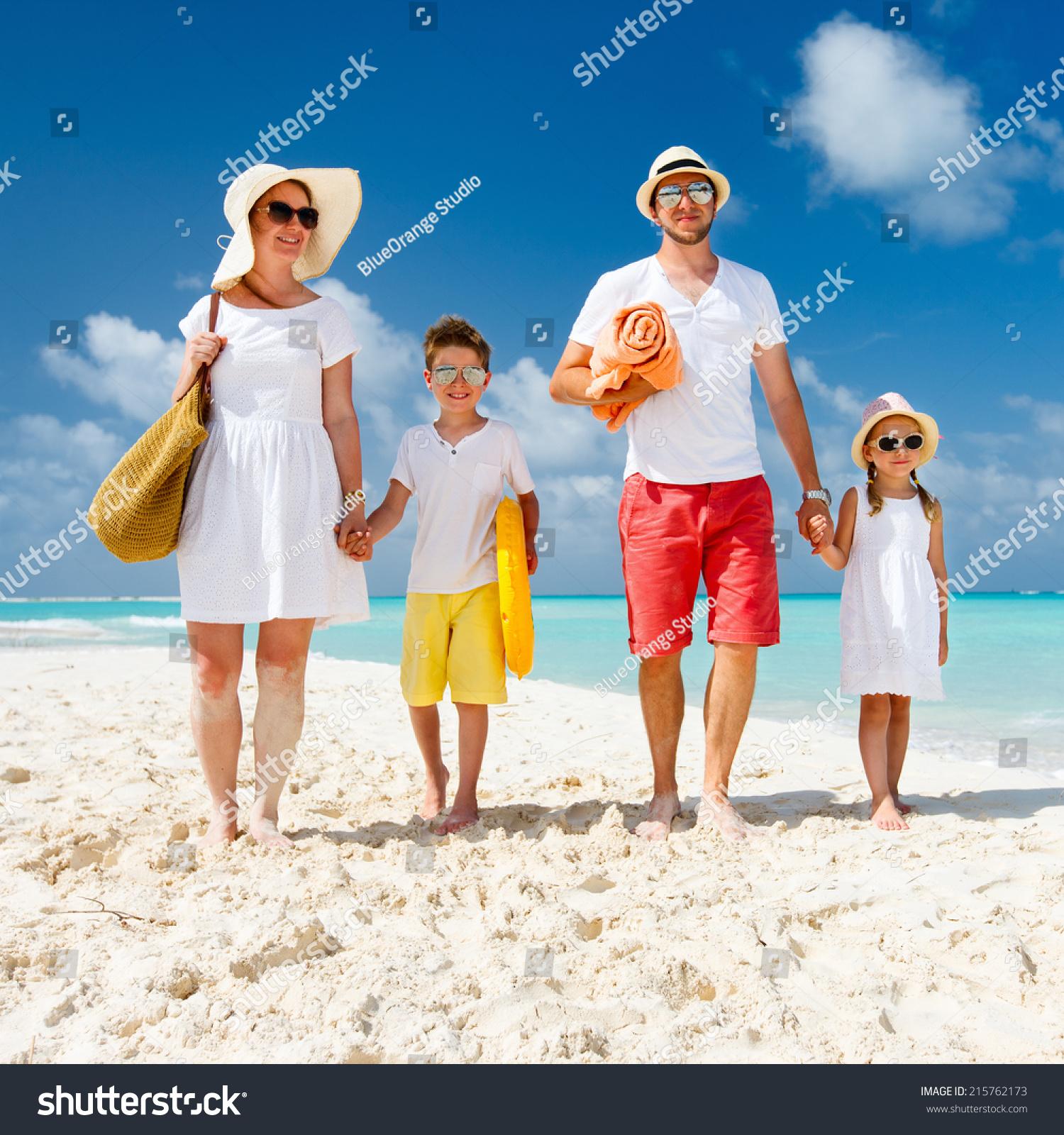 Happy Beautiful Family On Tropical Beach Stock Photo