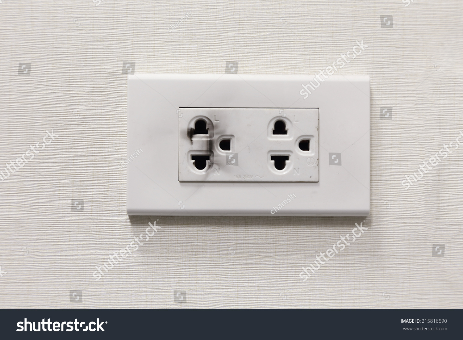 Electrical switch and plug on wall in Thailand | EZ Canvas