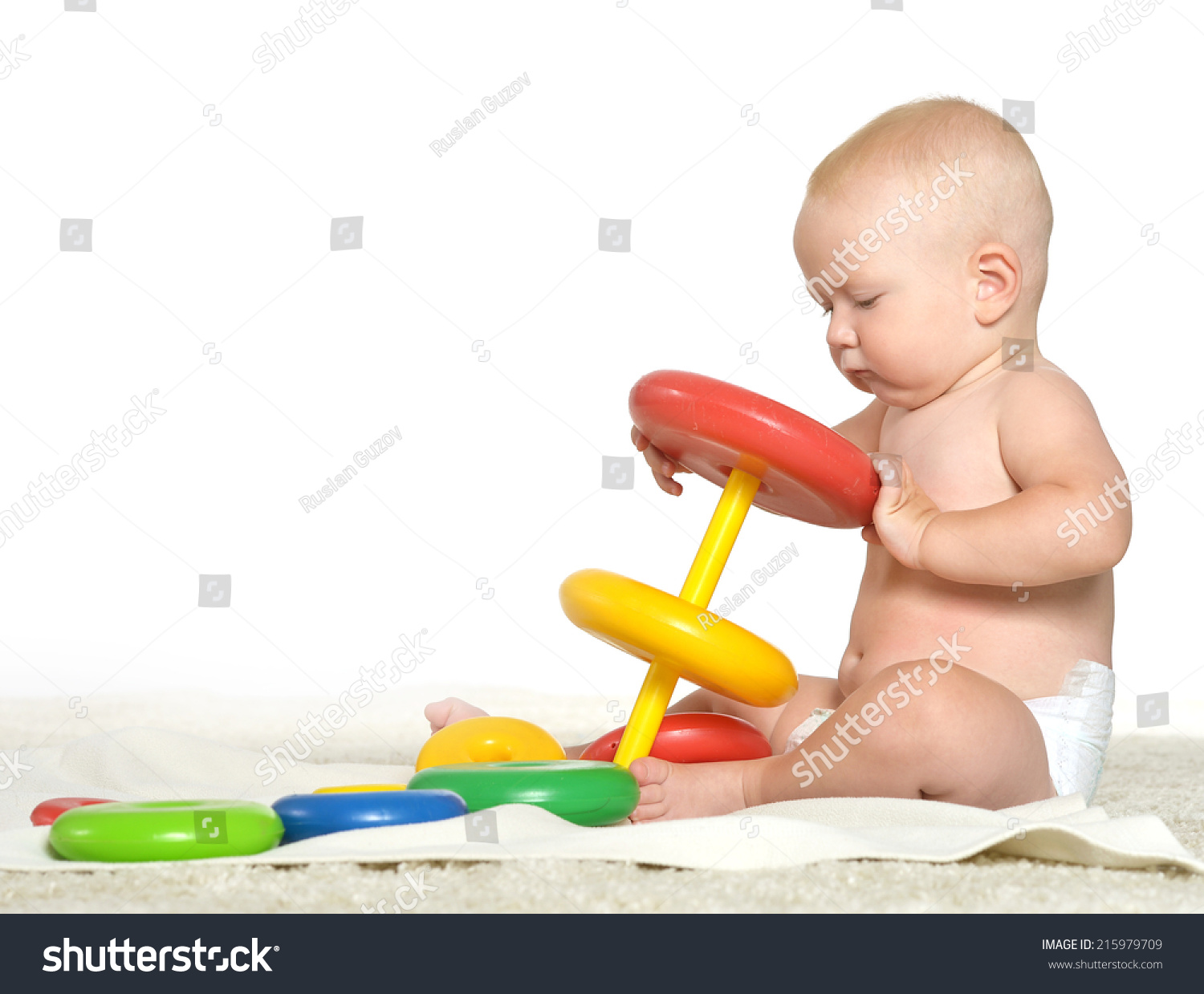 Boy Toys Background : Baby boy playing with toys on a white background stock