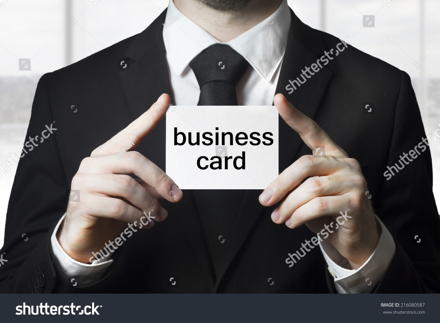 Businessman holding business card sign stock photo 216080587 businessman holding business card sign magicingreecefo Images