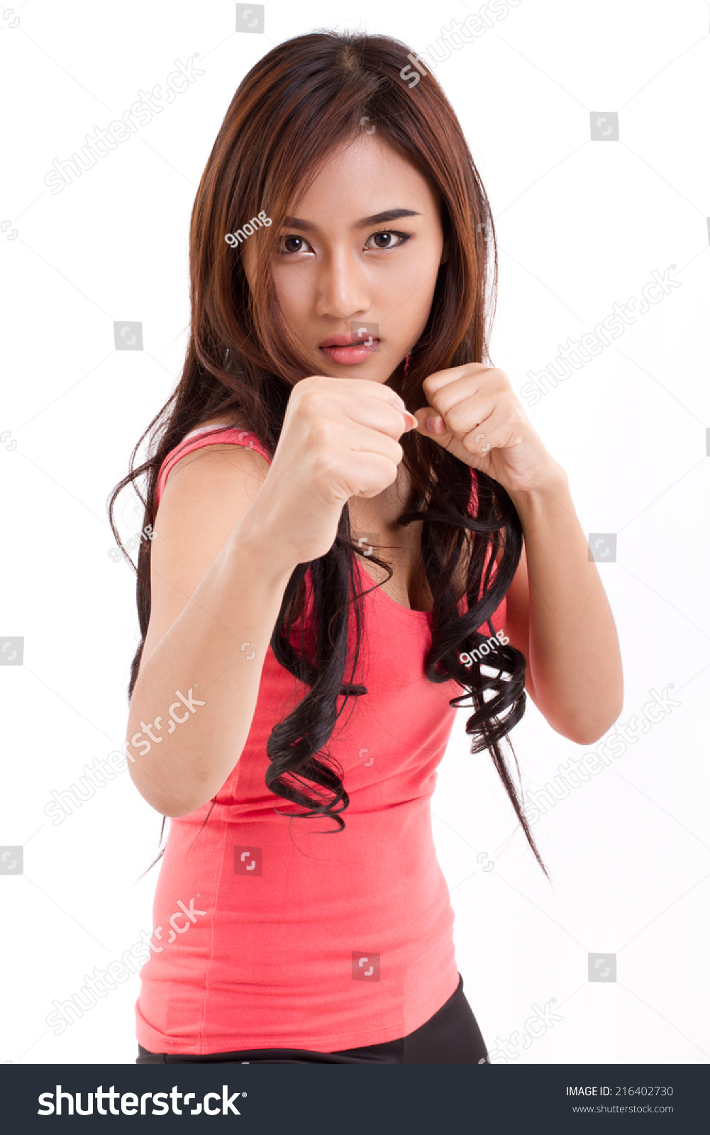 Portrait of female fighter boxer posing fighting stance stock photo