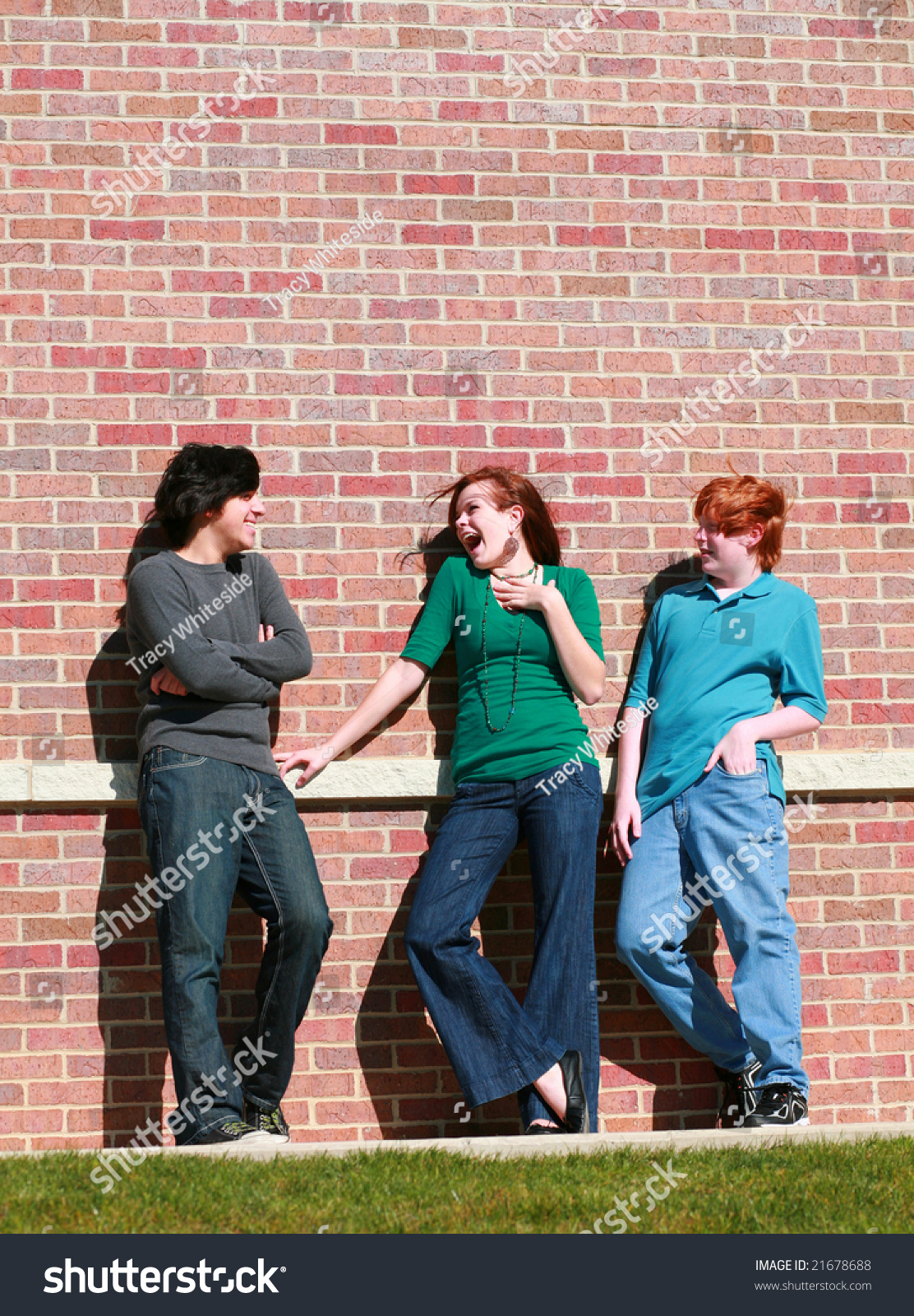 pretty teen girl flirting with teen boys