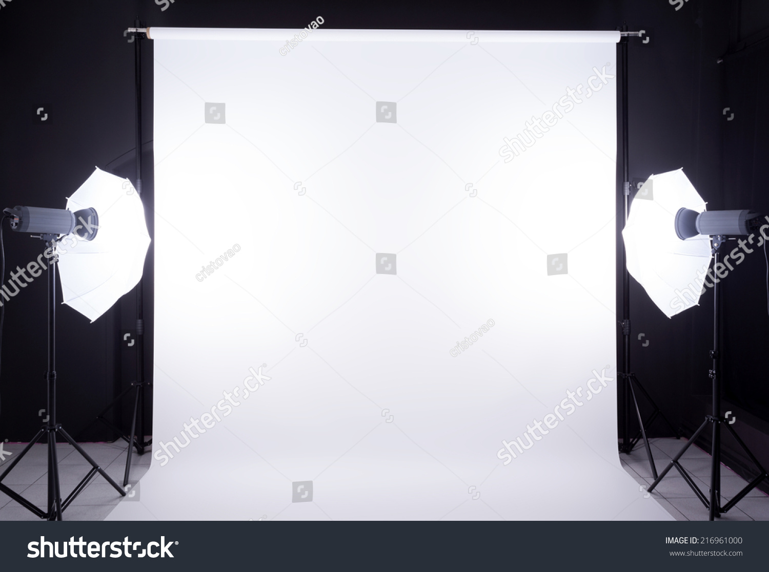 Modern photo studio with lighting equipment