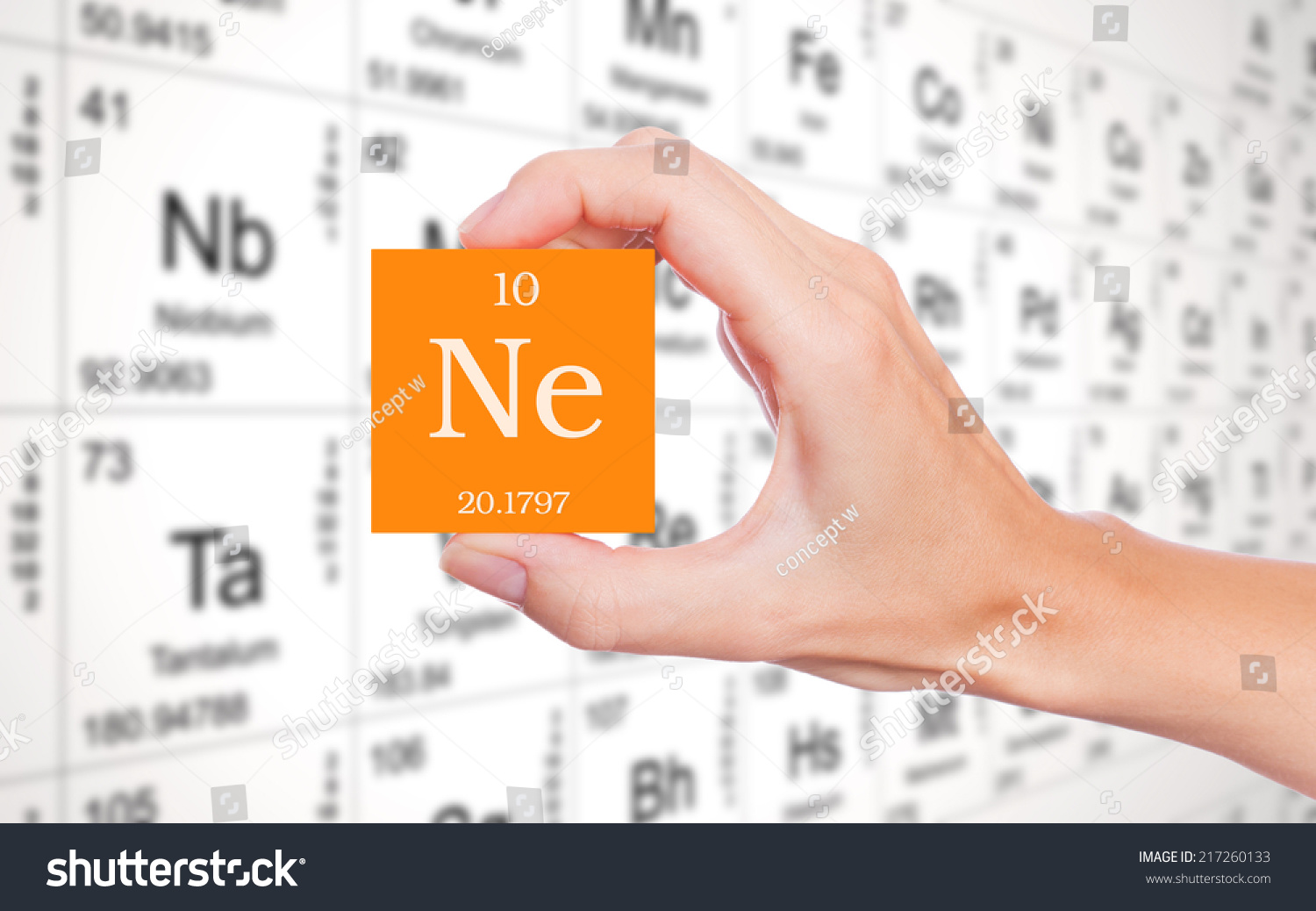 Neon symbol handheld front periodic table stock photo 217260133 neon symbol handheld in front of the periodic table buycottarizona Images