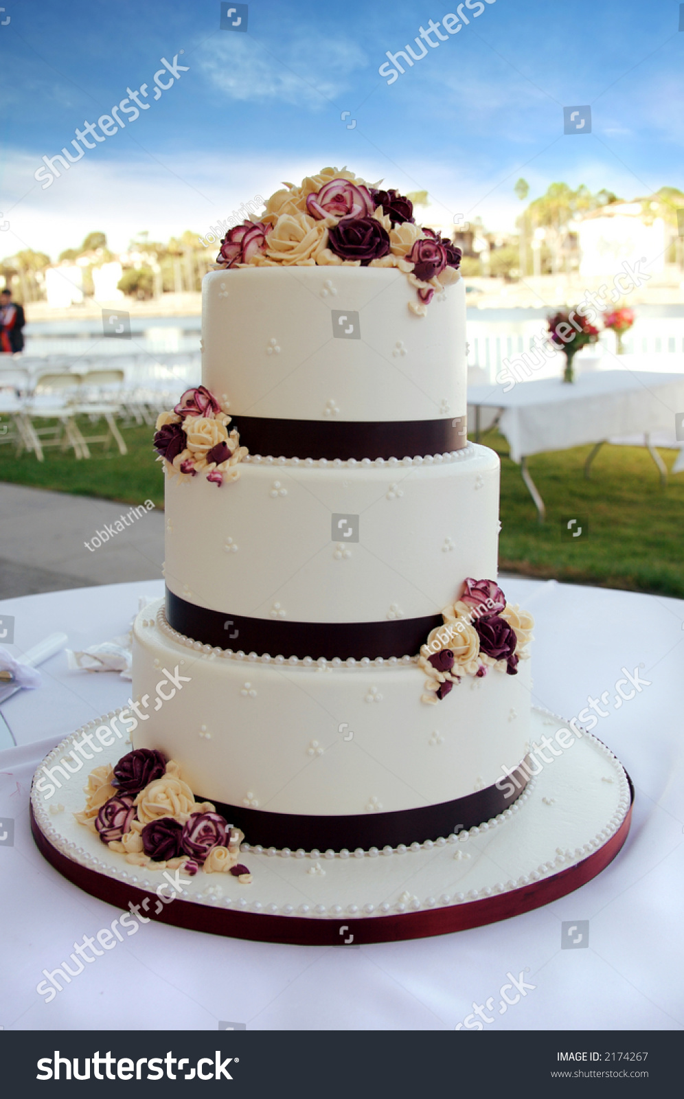 Beautiful White Burgundy Wedding Cake Flowers Stock Photo