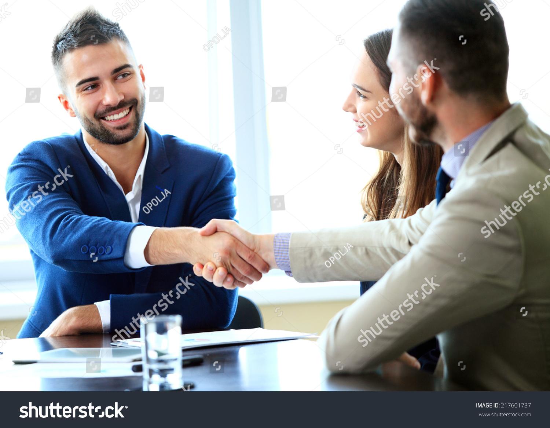 Handshake between office workers — Stock Photo © svyatoslavlipik ...