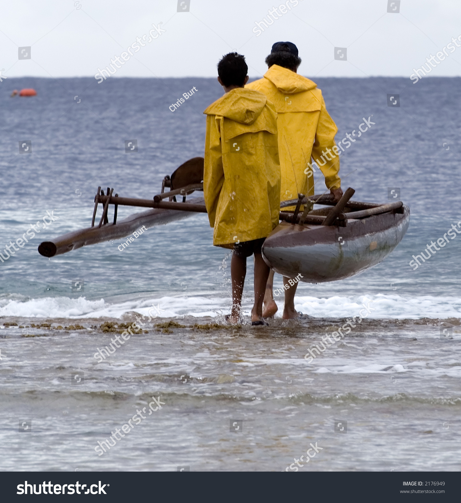 Father And Son Launching An Outrigger Canoe Off The Reef. Father ...