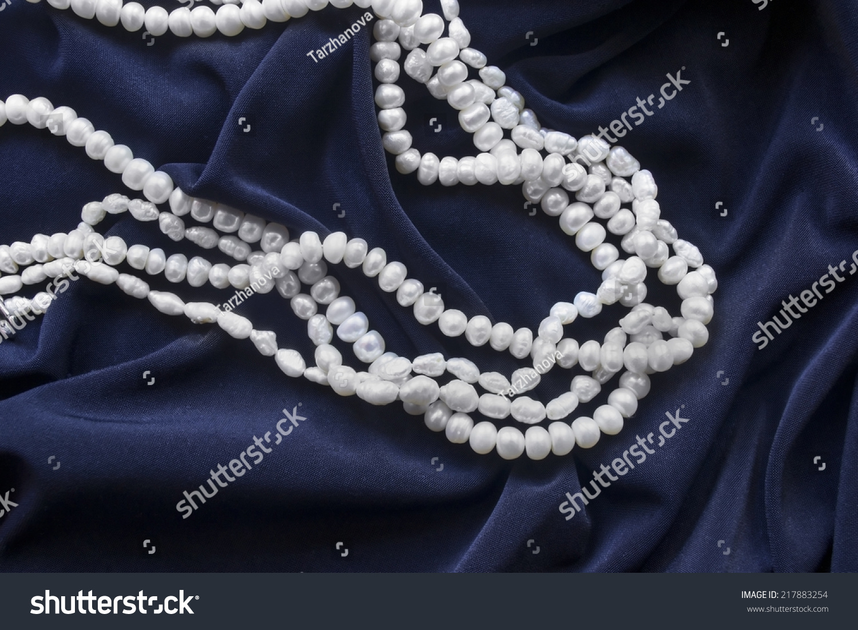 Strings White Pearl On Dark Blue Stock Photo Edit Now
