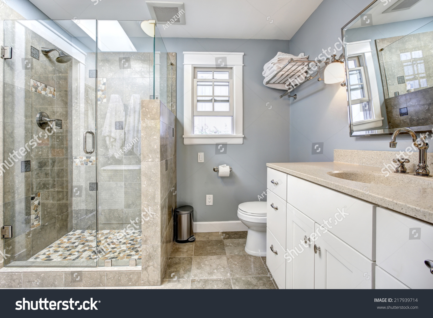 Modern blue and white bathroom - Light Blue Modern Bathroom Interior With Glass Door Shower And White Cabinet With Mirror
