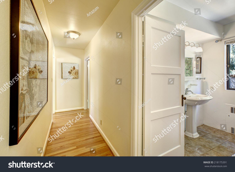 Narrow Hallway Hardwood Floor Ivory Walls Stock Photo (Royalty Free ...
