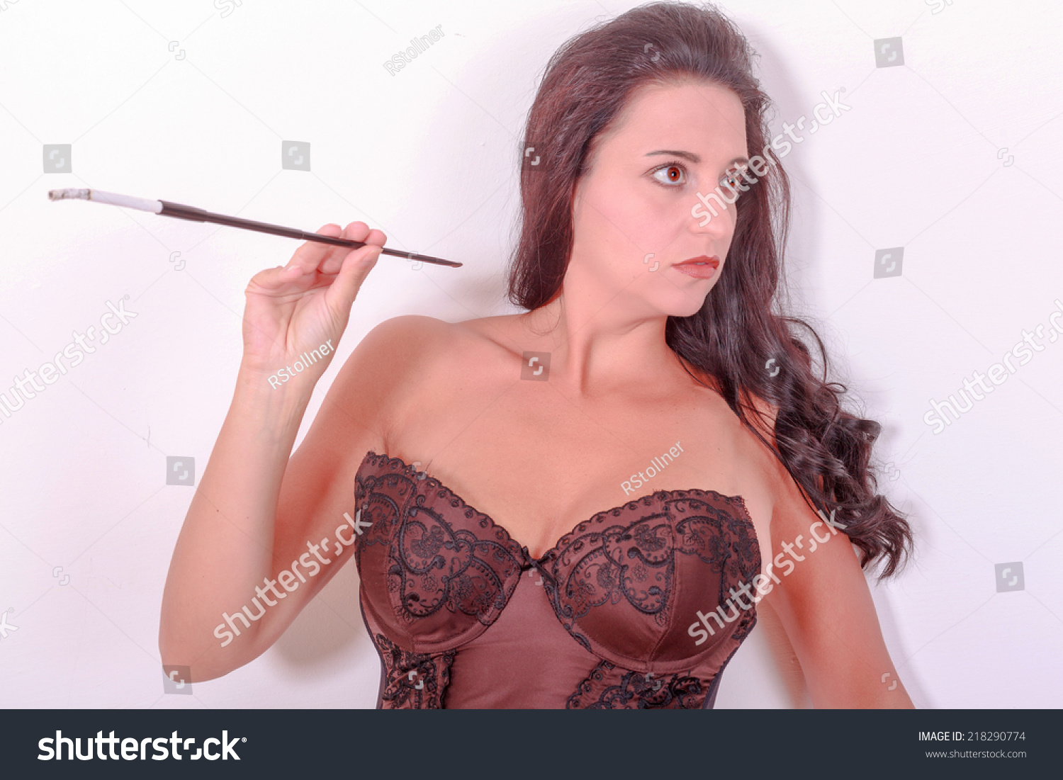 girl in sexy lingerie smoking a cigarette