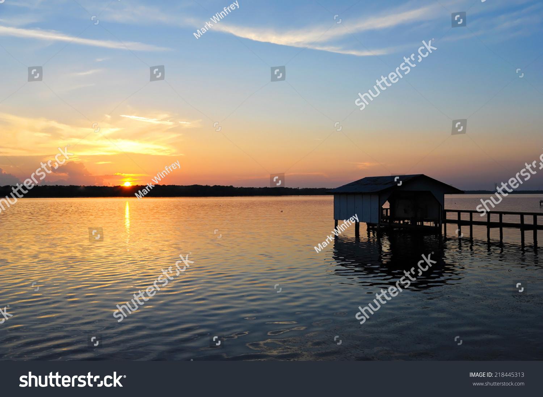 stock-photo-fishing-boat-dock-at-sunset-