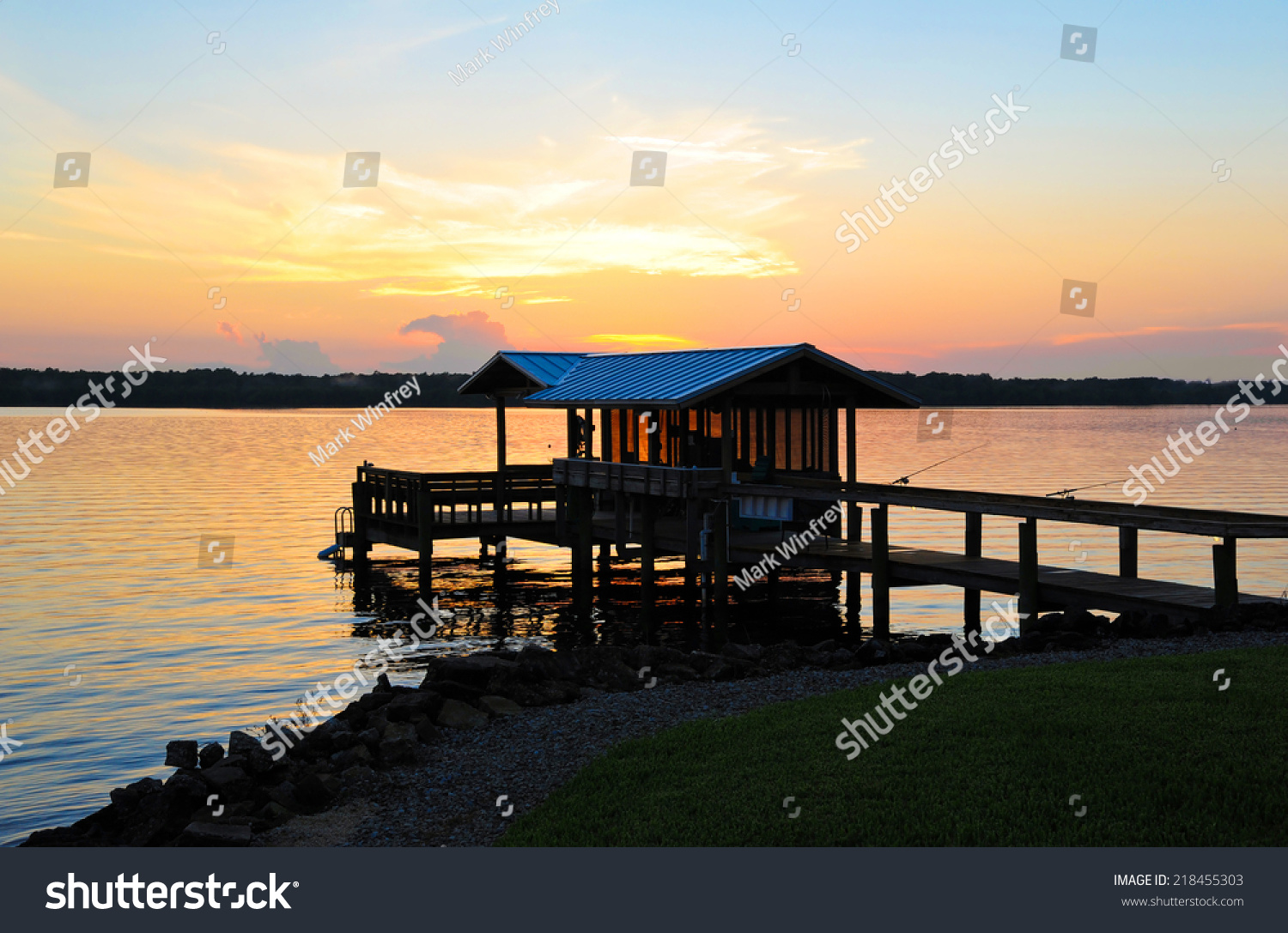 stock-photo-fishing-boat-dock-at-sunset-