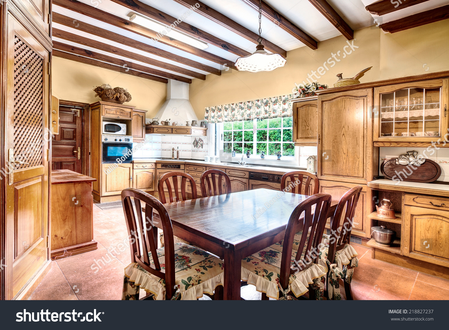 Country style kitchen with dining room stock photo - Sala da pranzo country ...
